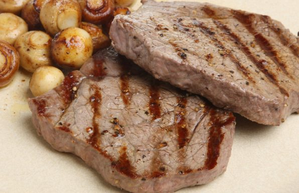 Steak with mushrooms.