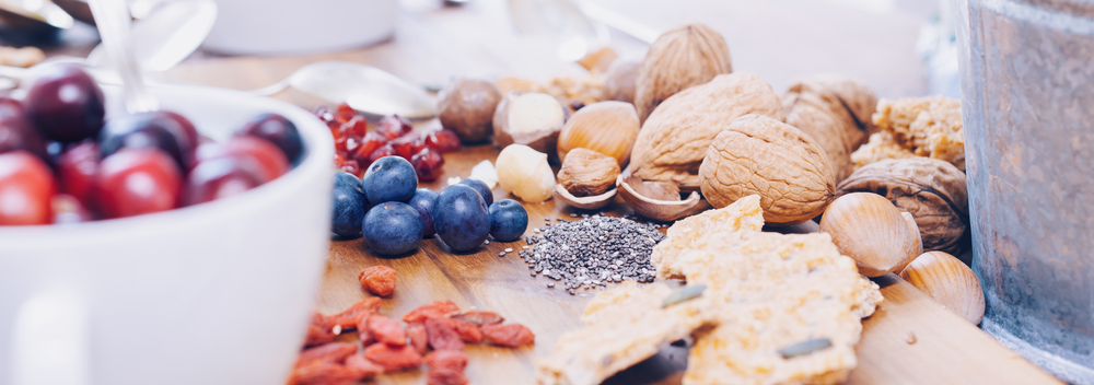 Berries, grains and other superfoods on a wooden table