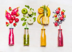 Superfood fruits juiced into glass bottles
