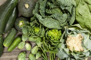 Leafy green superfoods including kale, cabbage and cauliflower