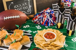 Snacks on table decorated like a football field