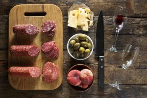 Charcuterie tray with meats, olives, cheese and fruit