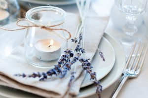 Romantic table setting with candle and lavendar