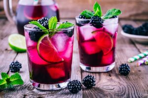 Blackberry mojitos on wooden table