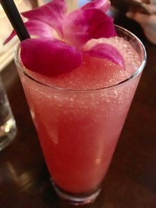 Strawberry frosé with flower garnish