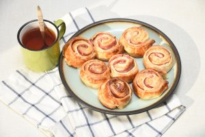 Ham and cheese pinwheels with a side of sauce
