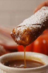 Pumpkin pie egg roll with dipping sauce