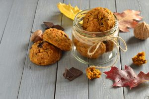 Pumpkin chocolate chip cookies in a clear jar