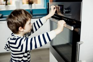 kid watching oven
