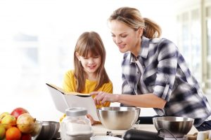mom and daughter reading recipe