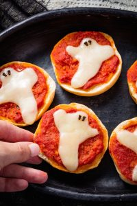 Spooky ghost pizza bagels.