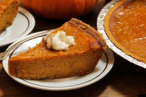 Sliced Thanksgiving pumpkin pie.