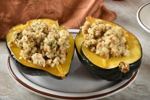 Roasted Acorn Squash stuffed with Thanksgiving stuffing.