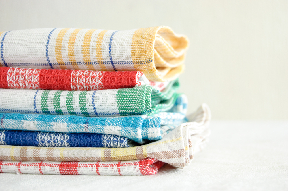 Stacked bright dish towels.