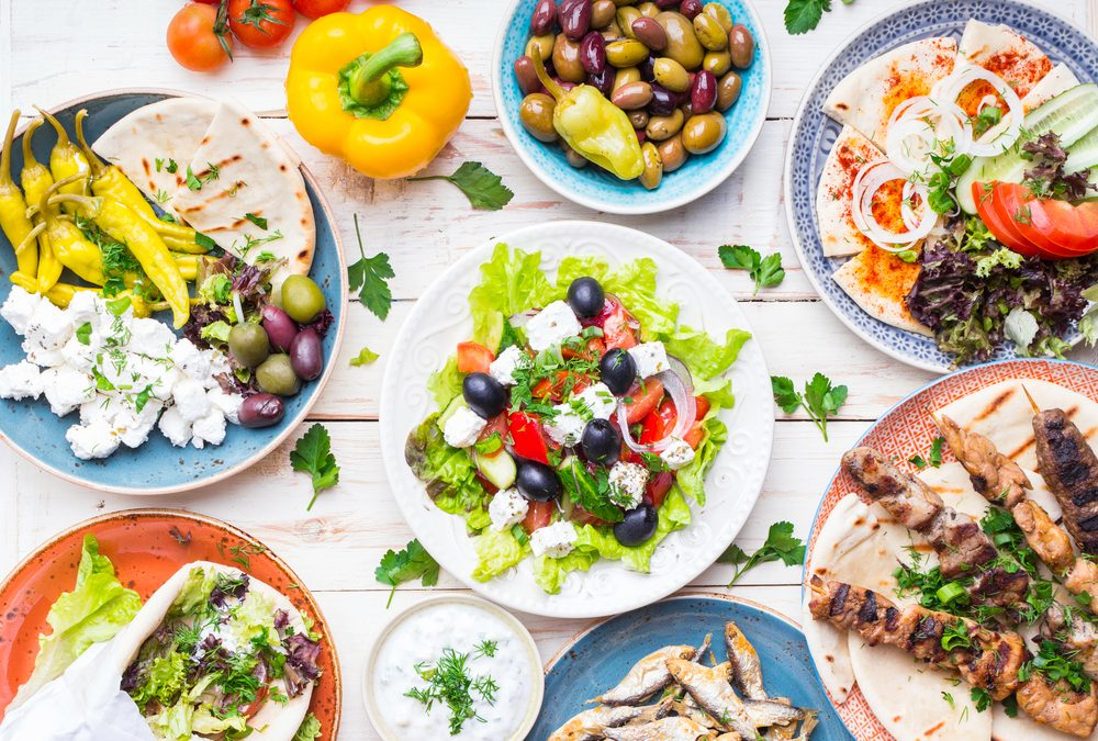 Tabletop with Greek dishes and ingredients