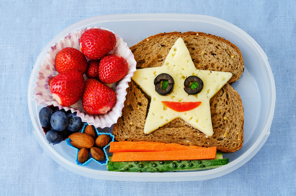 Lunchbox packed with sandwich with star-shaped cheese